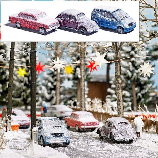 3 verschneite Autos